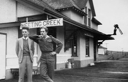 Brothers Dick Fowler and W.F. (Bill) Fowler pose for their brother Fred at the Meeting Creek Depot in 1943, at the height of the Second World War. Upon Bill Fowler's release from the service, he would become a station agent and train dispatcher, retiring in the 1990s.