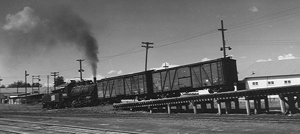Shoving box cars full of coal to the Calder coal dock, Edmonton, 1943.  ©photo N.F. Corness Archives