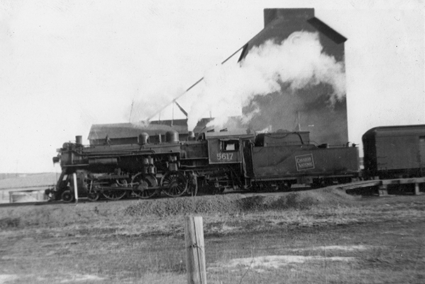 Train No. 25 with coal fired steam locomotive 5617 at Rumsey, Alberta.  ©photo G.F. Fowler Archives